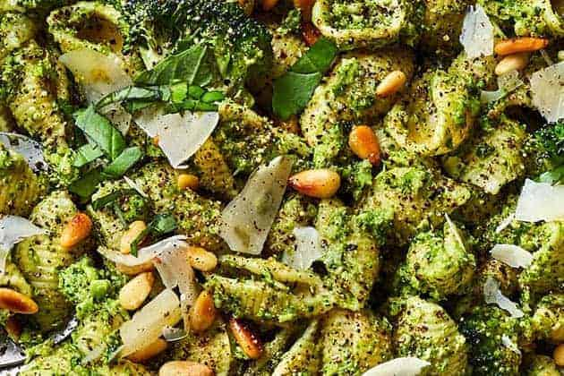 Close up of a bowl of broccoli pesto pasta