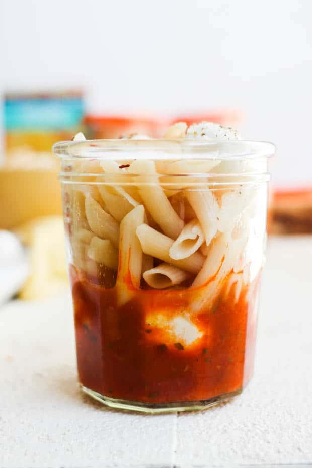 A close up of a prepared gluten free pasta snack jar