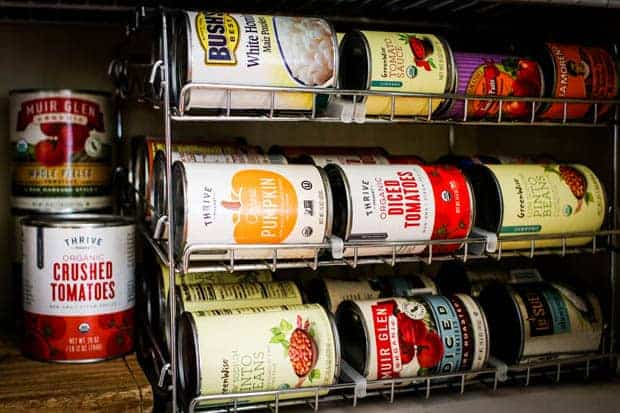 A variety of canned goods in a pantry.