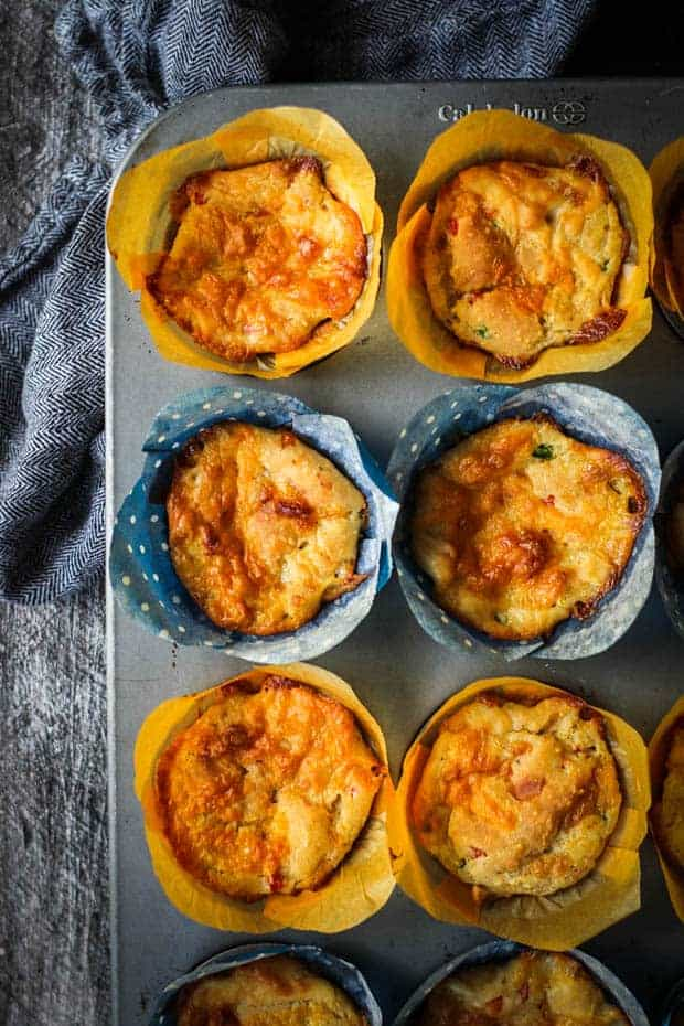 6 pimento cheese muffins in a muffin pan on a table