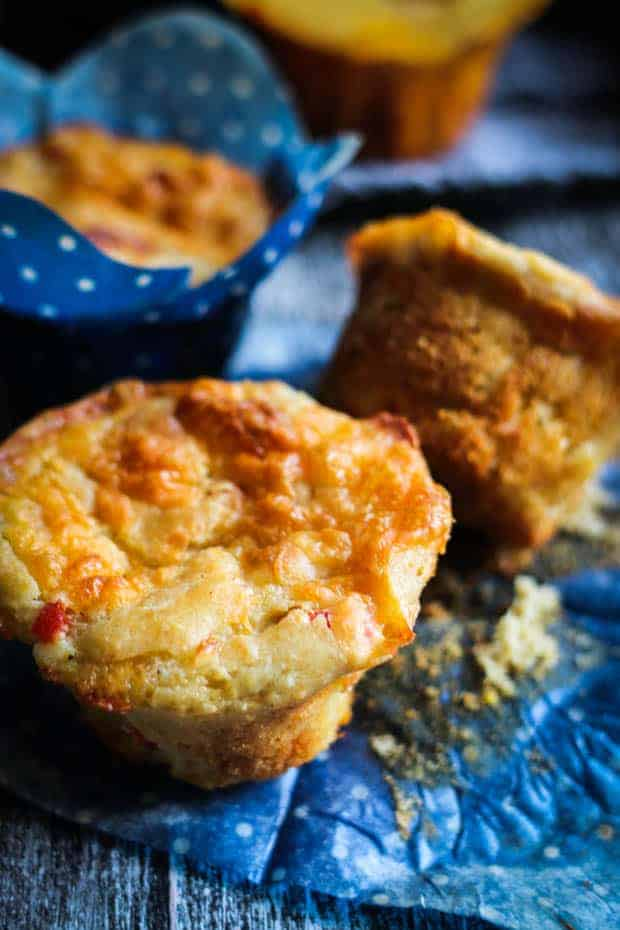 Pimento Cheese Muffins out of the wrappers on a table.