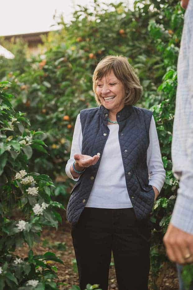 California's Secretary of Agriculture, Karen Ross, standing in a tomato green house.
