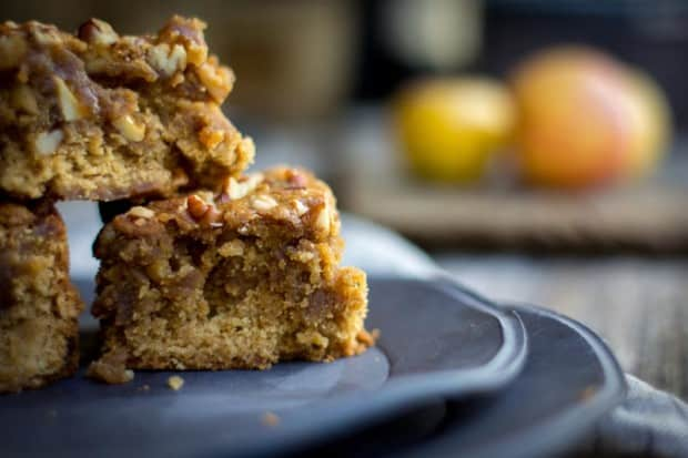 A stack of 3 apple brown butter blondies on a black plate