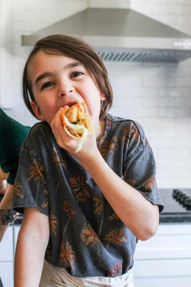 A boy enjoying a Crunchy Gluten Free Avocado Taco