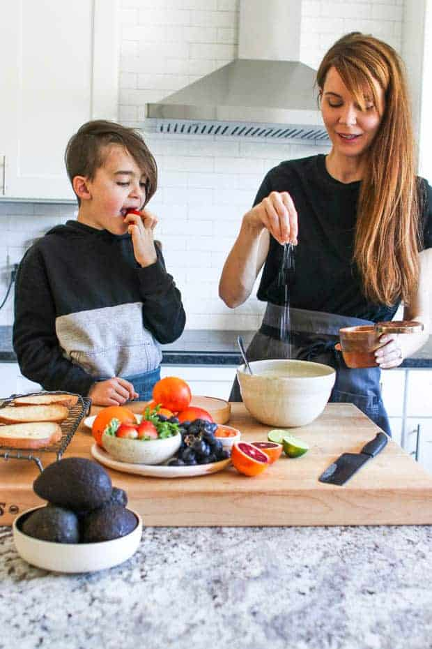 A woman and a young boy making Fruity Avocado Toast together
