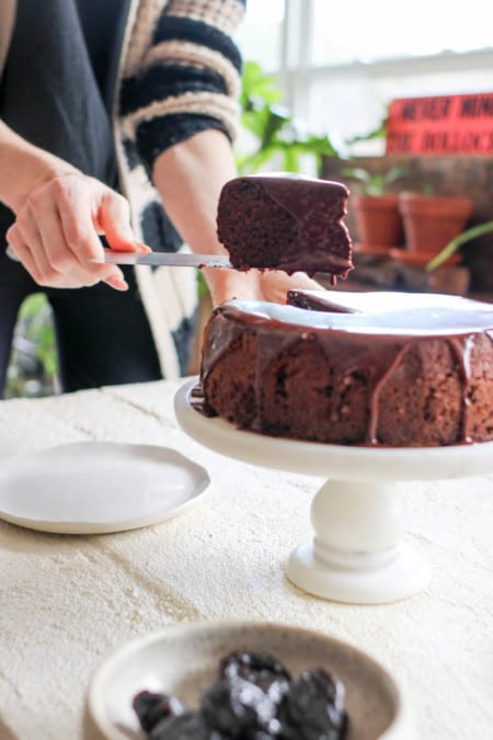 A slice of Chocolate Covered Prune Fudge Cake being plated