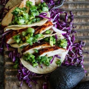 3 Easy Grilled Enchilada Chicken tacos with green salsa and red cabbage