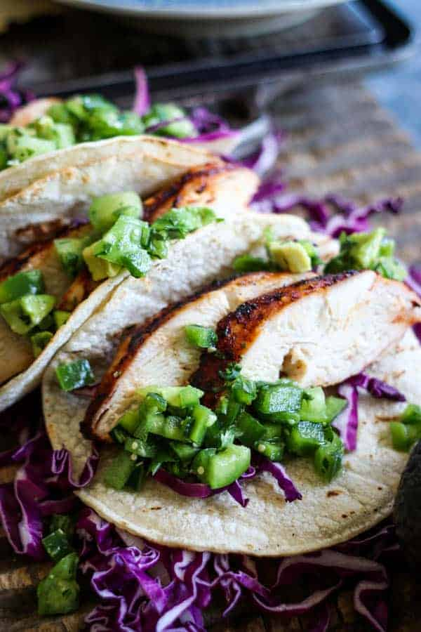 Grilled chicken tacos topped with verde pico de gallo