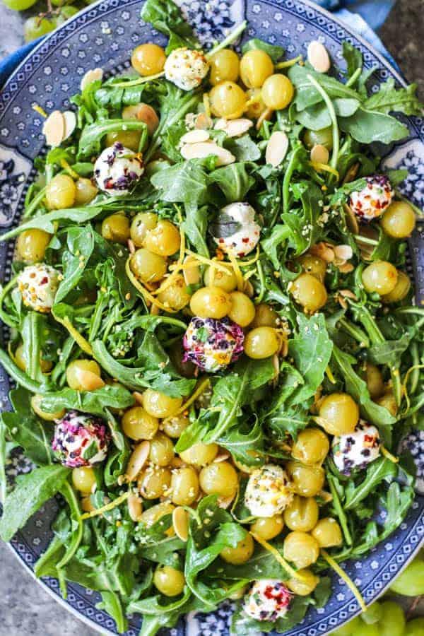A close up of Roasted Grape & Arugula Salad