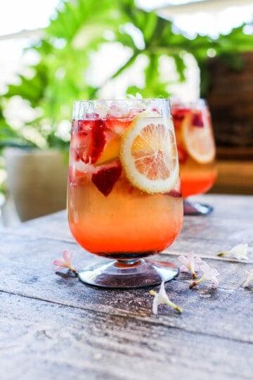 A Strawberry Lemon Smash Cocktail with fresh strawberries and lemon wheels