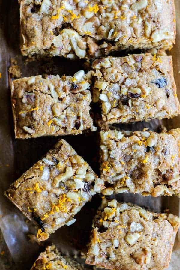 A close up of The Most Delicious Snack Cake cut into 8 squares.