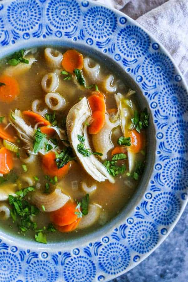 A bowl of homemade chicken stock made using The Easiest DIY Rotisserie Chicken Broth
