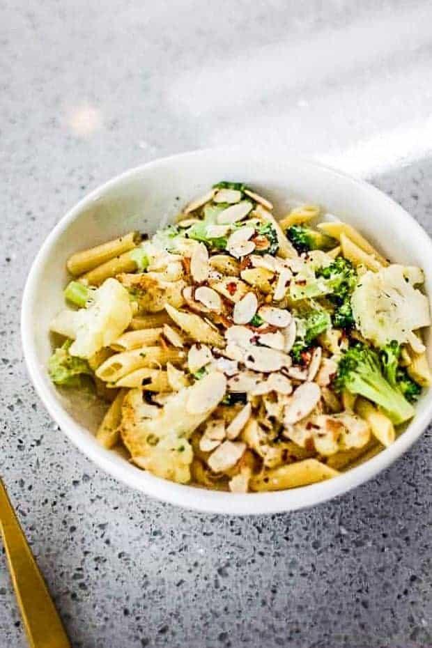 Bowl of lemon pasta with broccoli and cauliflower