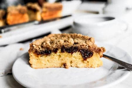 A slice of Weekend Coffee Cake Crumble on a white dessert plate