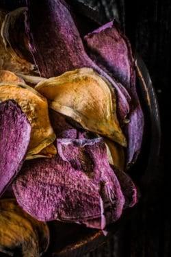 A close up of orange and purple Dehydrated Sweet Potato Dog Treats