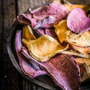 A bowl of red and purple sweet potato dog treats