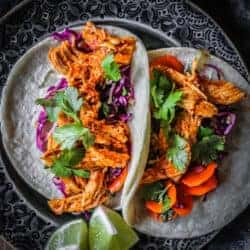 Two shredded chicken tacos on a plate