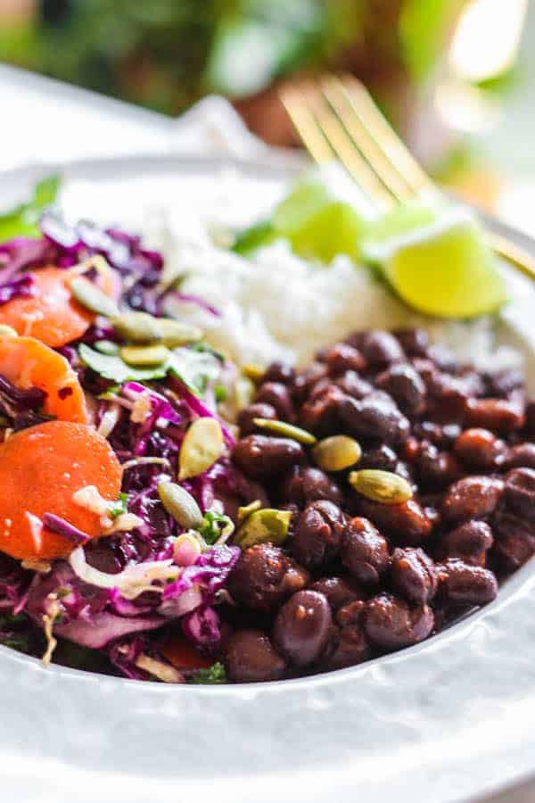 A close up of black beans in a burrito bowl