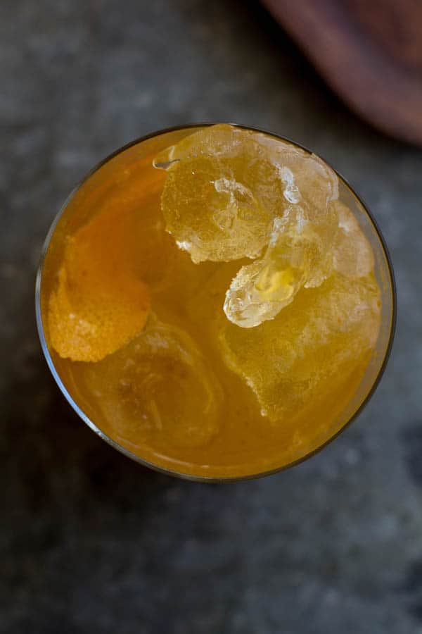 A top down image of the a pumpkin butter dark and stormy cocktail.