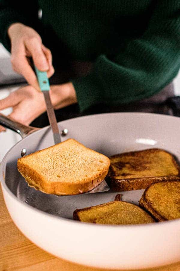 French toast in a skillet being flipped