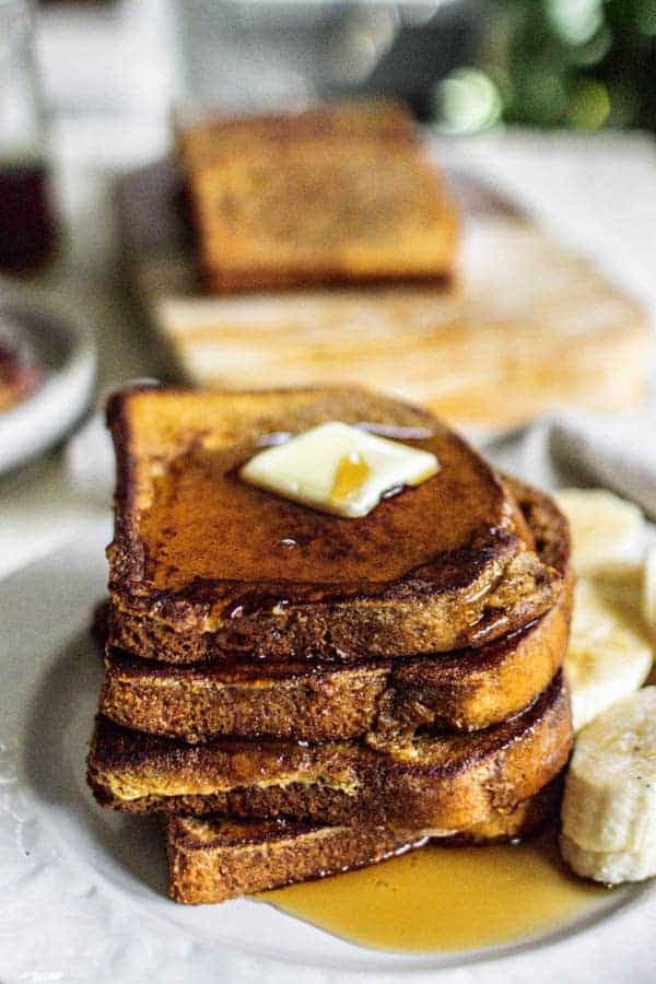 A stack of French toast with butter and maple syrup