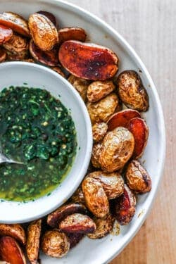 A bowl of crispy oven roasted potatoes with chimmichuri