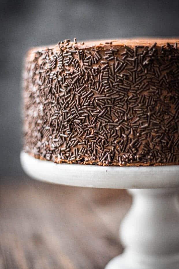 Close up of chocolate sprinkle decoration on chocolate cake