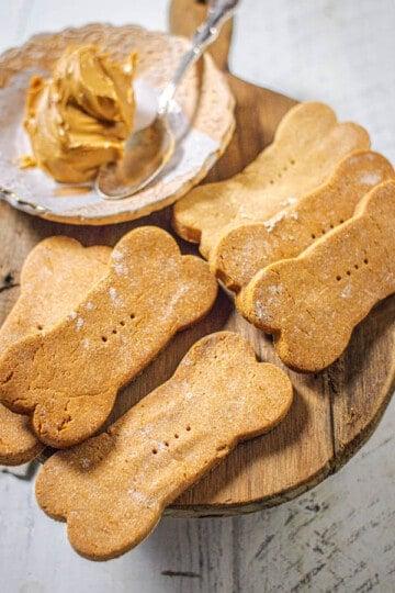 A close up of bone shaped, baked peanut butter dog treats