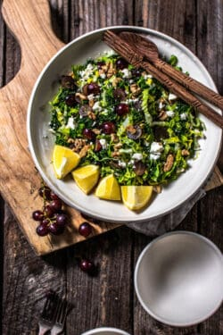 A bowl of Kale Salad with Red Grapes, Walnuts, and Feta