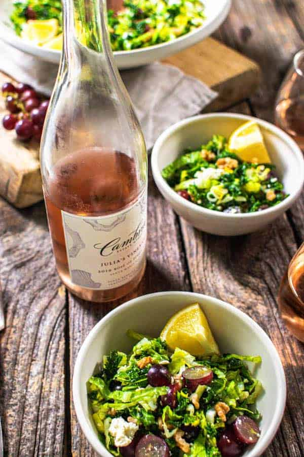 Julia's Vineyard Rose from Cambria Winery next to a bowl of kale salad