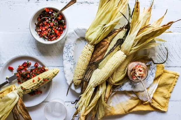 A platter of oven roasted corn and pico de gallo butter.
