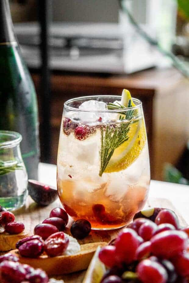 This blog post contains recipes for grapes like this Rosemary and Roasted Grape Wine Cocktail recipe